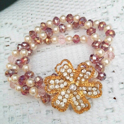 3 Strand Stretch Pearl and Crystal Bracelet With A Gold Plated Rhinestone Flower
