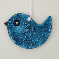 7805942-Blue-hanging-bird-embossed-clay-decoration--0